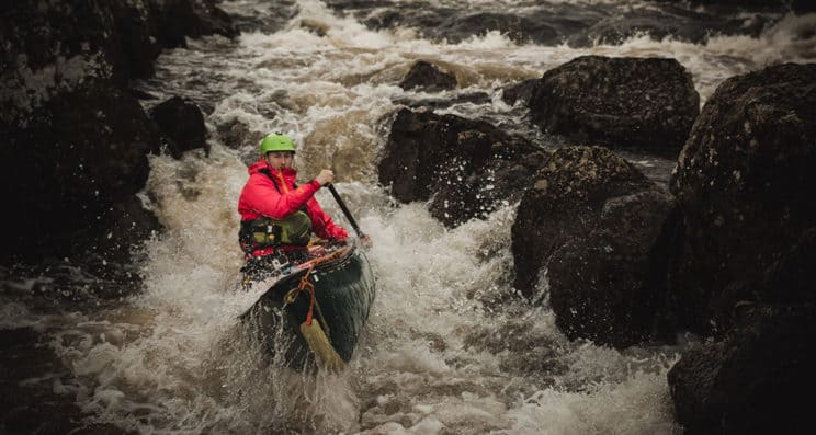 Advanced White Water OC1 Leader. A leader in an OC1 heads over advanced white water.