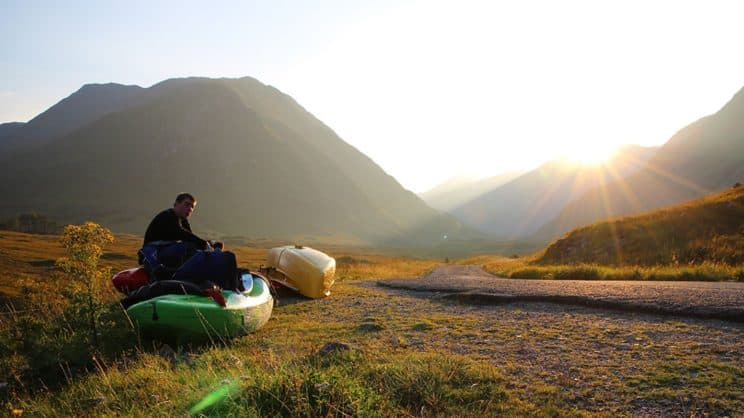 Outdoor Education. A paddler sits in a kayak in the countryside.