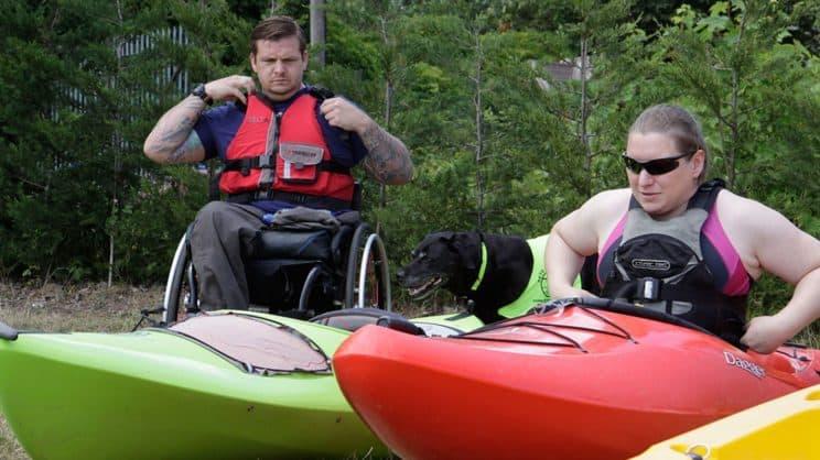 Paddle-Ability. A paddler in a wheelchair is getting ready to go paddling.
