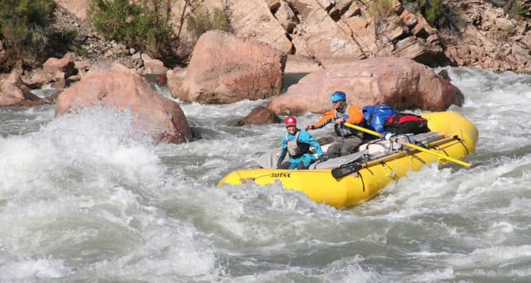 River Raft Guide.A raft heads down white water.