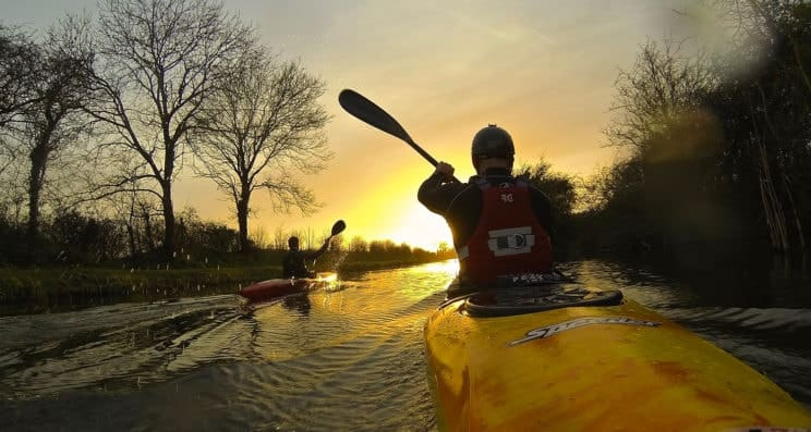 3 Star Award paddlers paddling into the sunset